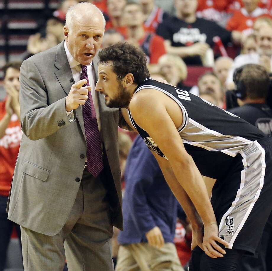San Antonio Spurs head coach Gregg Popovich talks with San Antonio Spurs' Marco Belinelli during first half action of Game 4 in the Western Conference semifinals against the Portland Trail Blazers Monday May 12, 2014 at the Moda Center in Portland, OR. Photo: San Antonio Express-News