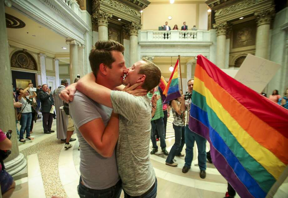 Brandon Armstrong, left, and Thomas Etheridge, both of Alexander, kiss and embrace after they were wed in the rotunda of the Pulaski County Courthouse in Little Rock, Ark. Monday May 12, 2014. (AP Photo/The Arkansas Democrat-Gazette, Stephen B. Thornton) Photo: Stephen B. Thornton, Associated Press