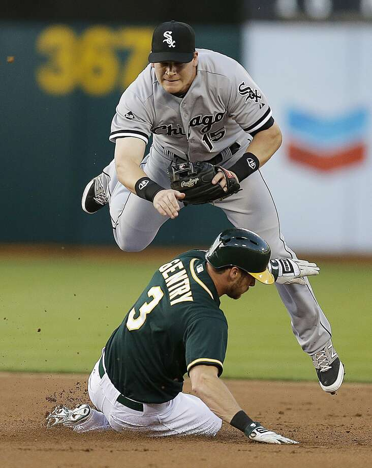 Chicago's Gordon Beckham avoids the sliding Craig Gentry while trying to turn a double play in the first inning. Photo: Ben Margot, Associated Press