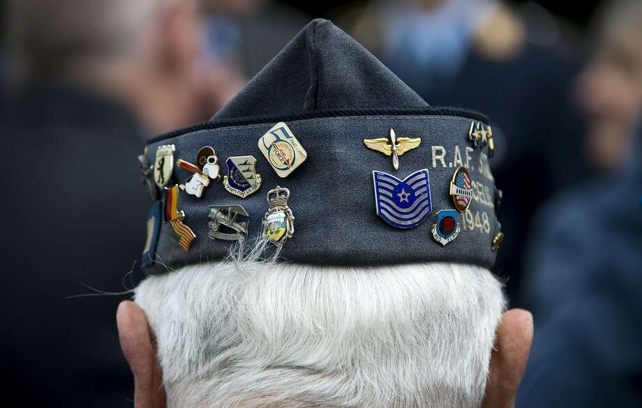 The hat of former US Air Force veteran Johnny Macia is pictured during a wreath laying ceremony on May 12, 2014, at the Berlin Airlift memorial outside Tempelhof airport in Berlin, commemorating the airlift during the Cold War Berlin blockade. Allied and German military officials, along with veterans of the airlift, commemorated the 65th anniversary of the end of the airlift which US and allied aircraft flew in 4.000 tons of food and supplies daily for the population of west Berlin for almost a year in Berlin.  TOPSHOTS/AFP PHOTO / JOHANNES EISELEJOHANNES EISELE/AFP/Getty Images Photo: Johannes Eisele, AFP/Getty Images