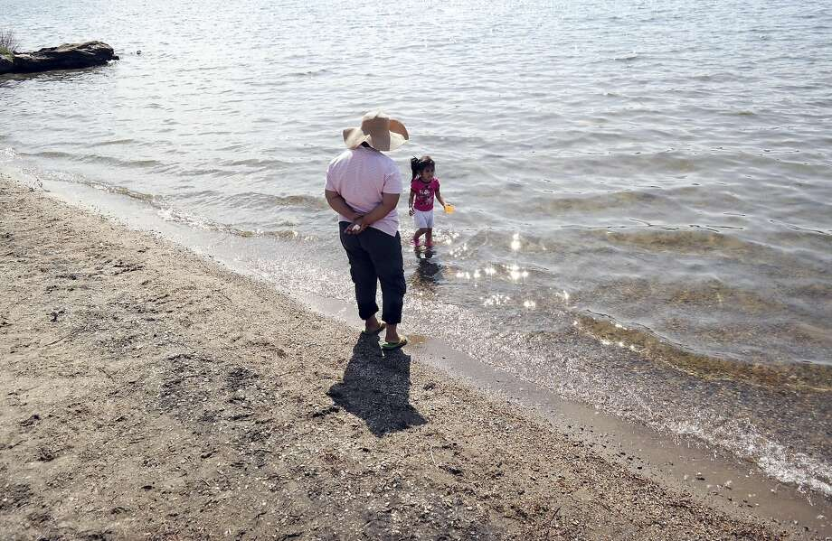 Ging Callejo keeps a careful eye on Emily Callejo, age 4, as she cools of at Onota Lake in Pittsfield, Mass., Monday May 12, 2014. Temperatures reached the 80s in New England. (AP Photo /The Berkshire Eagle, Ben Garver) Photo: Ben Garver, Associated Press