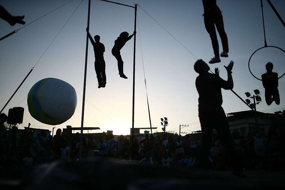 RIO DE JANEIRO, BRAZIL - MAY 12:  Artists from the Cia Base circus group perform in the show Futebol Voador (Flying Soccer) during the International Circus Festival in the Vila Cruzeiro slum, or favela, on May 12, 2014 in Rio de Janeiro, Brazil. The International Circus Festival runs until May 18 in Rio and the 2014 FIFA World Cup begins June 12.  (Photo by Mario Tama/Getty Images) ***BESTPIX*** Photo: Mario Tama, Getty Images