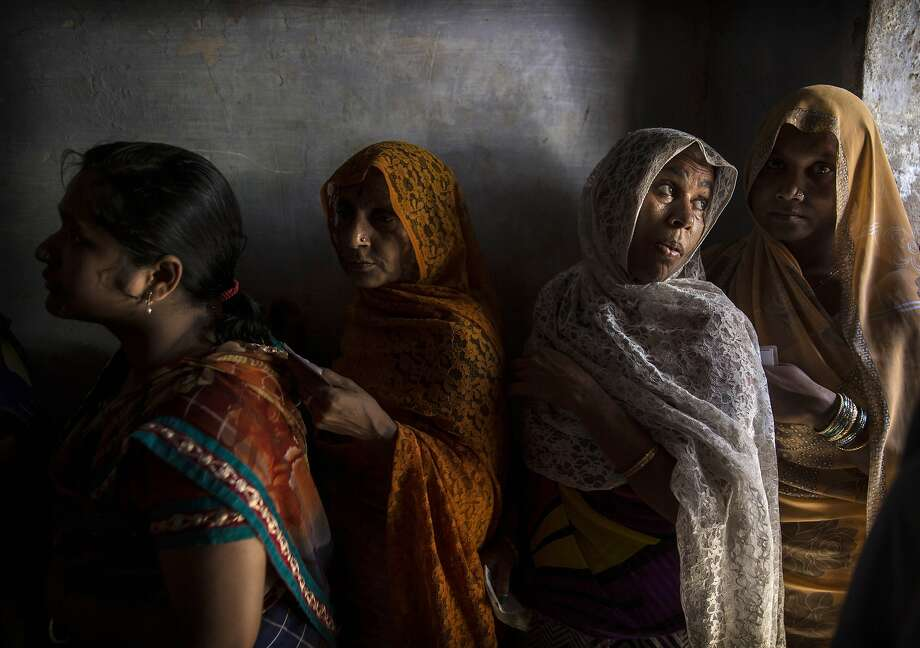 VARANASI, INDIA - MAY 12: Indian women wait in line to vote at a polling station on May 12, 2014 in Varanasi, India. Indians voted in the ninth and final phase of elections Monday. Counting will be on May 16.  (Photo by Kevin Frayer/Getty Images) *** BESTPIX *** Photo: Kevin Frayer, Getty Images