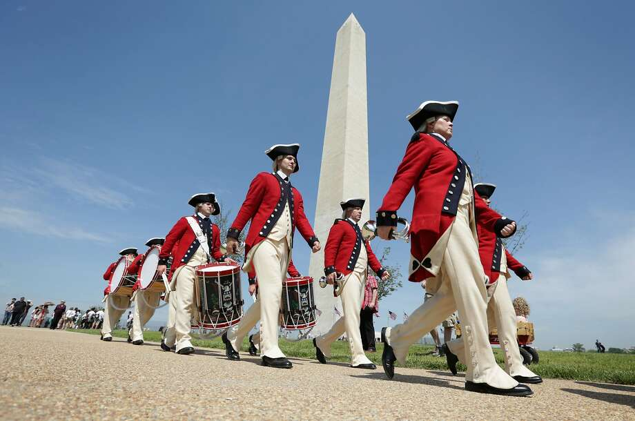 WASHINGTON, DC - MAY 12:  Members of the U.S. Army Old Guard Fife and Drum Corps march pass in front of the Washington Monument during a reopening ceremony for the monument May 12, 2014 in Washington, DC. The Washington Monument was reopened after it has been closed for a restoration due to the damages caused by a 5.8-magnitude earthquake that struck the Washington, DC, area on August 23, 2011.  (Photo by Alex Wong/Getty Images) Photo: Alex Wong, Getty Images