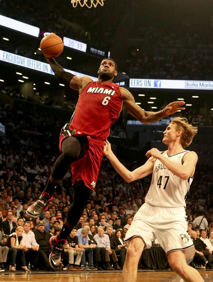 LeBron James dunks over the Nets' Andrei Kirilenko on his way to 49 points in Game 4. Photo: Charles Trainor Jr, McClatchy-Tribune News Service
