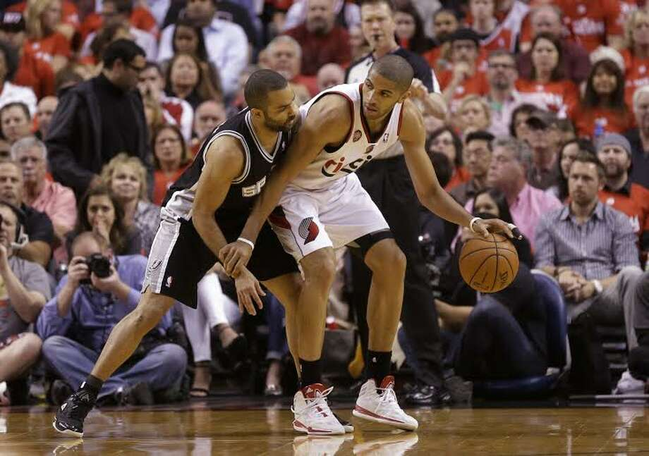 Express-News Spurs writers Jabari Young and Jeff McDonald discuss Game 4 and also hear from Tim Duncan, Boris Diaw and Manu Ginobili and Damian Lillard Express-News Postgame Wrap. Photo: Rick Bowmer, San Antonio Express-News