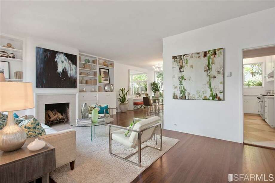 The main entertaining level has tall ceilings, dark hardwoods and natural light. Photo: SF Properties