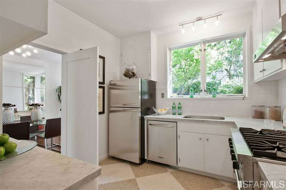 The kitchen has marble countertops and a Viking stove. Photo: SF Properties