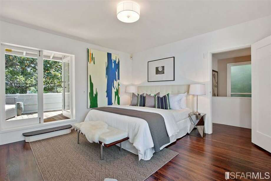 The master bedroom has French doors out to a deck overlooking the patio. Photo: SF Properties