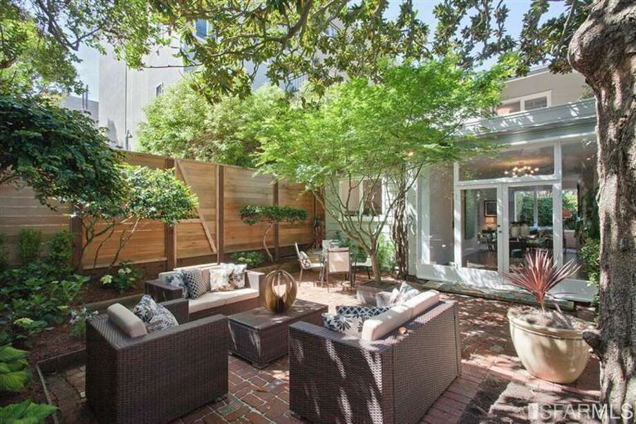The courtyard feels private thanks to mature Magnolia and Japanese maple trees. Photo: SF Properties