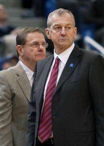 Connecticut head coach Jim Calhoun, right, and associate head coach George Blaney, left, stand up after a timeout during first half of an NCAA college basketball game against Cincinnati in Hartford, Conn., on Saturday, Feb. 13, 2010. This is Calhoun's first game back after a three-week medical leave which forced him to miss seven games. Photo: AP Photo/Thomas Cain