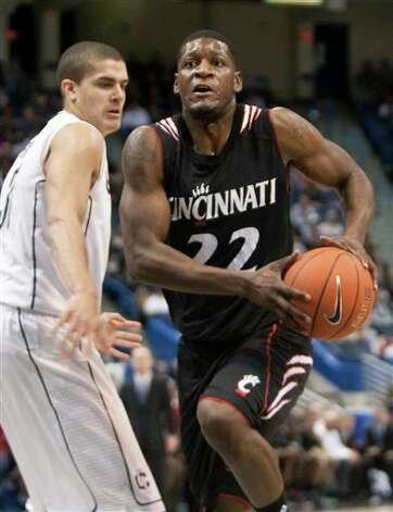 Cincinnati's Rashad Bishop, right, drives the ball past Connecticut's Gavin Edward's, left, during first half of an NCAA college basketball game in Hartford, Conn., on Saturday, Feb. 13, 2010. Photo: AP Photo/Thomas Cain