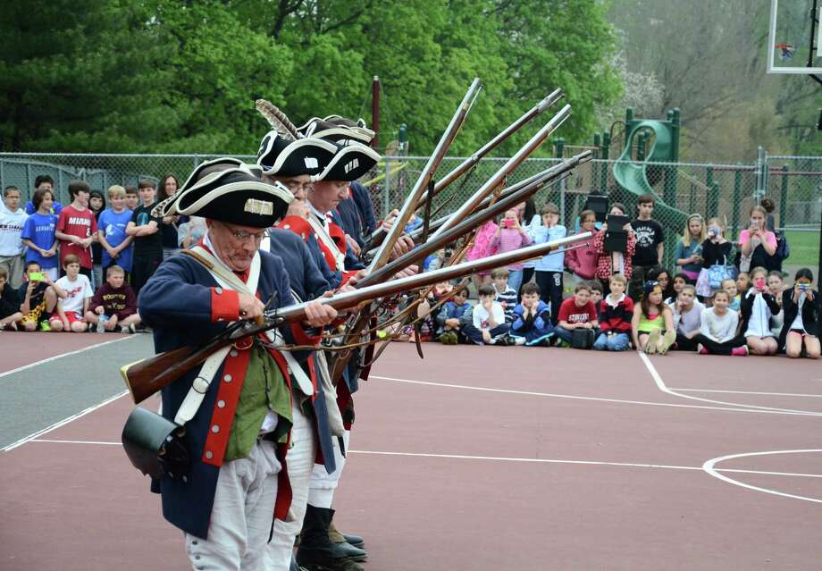 """Soldiers"" of the Fifth Connecticut Regiment get ready to fire their muskets during a Colonial Day presentation to fifth-graders at Saxe Middle School, in New Canaan, Conn, Friday, May 9, 2014. Photo: Nelson Oliveira / New Canaan News"