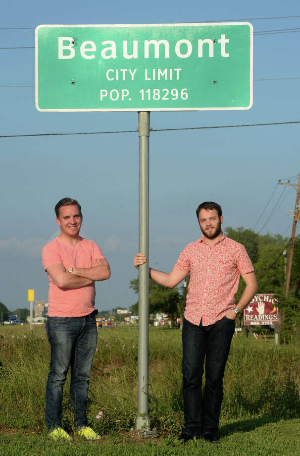 Recently moved to Beaumont, from left, Marcus Powers and Steven Kibodeaux stand by the Beaumont city limits sign.  Photo taken April 23, 2014 Guiseppe Barranco/@spotnewsshooter Photo: Guiseppe Barranco, Photo Editor
