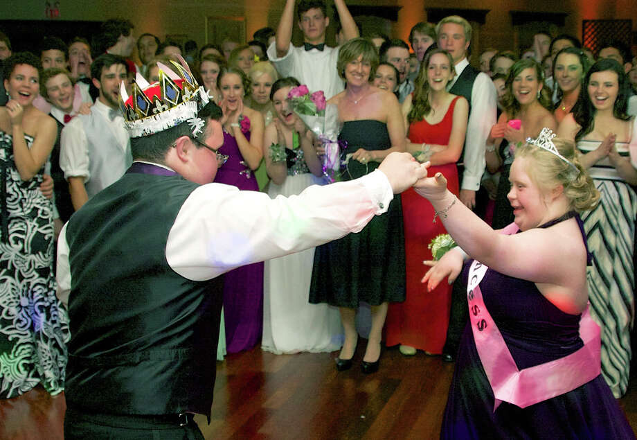 Greg Kenny and Marissa Perrault share a heartrfelt dance as Prince and Princess of the New Milford High School Junior Prom, held May 3, 2014 at the Amber Room Colonnade in Danbury. Photo: Trish Haldin / The News-Times Freelance