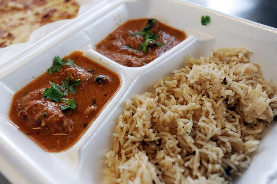 Beaumont Fried Chicken located on the corner of Calder Avenue and 7th Street offers Indian food every Friday.  On Friday, January 25, 2013, Susan whipped up butter chicken, rice, naan bread, and kidney beans.  All this is served in one plate for $7.99 and every Friday is a different dish. Photo taken: Randy Edwards/The Enterprise Photo: Randy Edwards