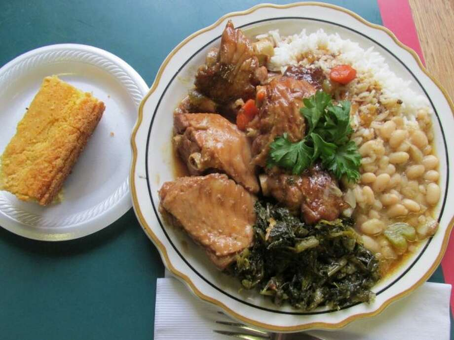 Big John's stewed turkey wing plate with rice and gravy, navy beans, mustard greens and cornbread, $10. Grace Mathis/cat5