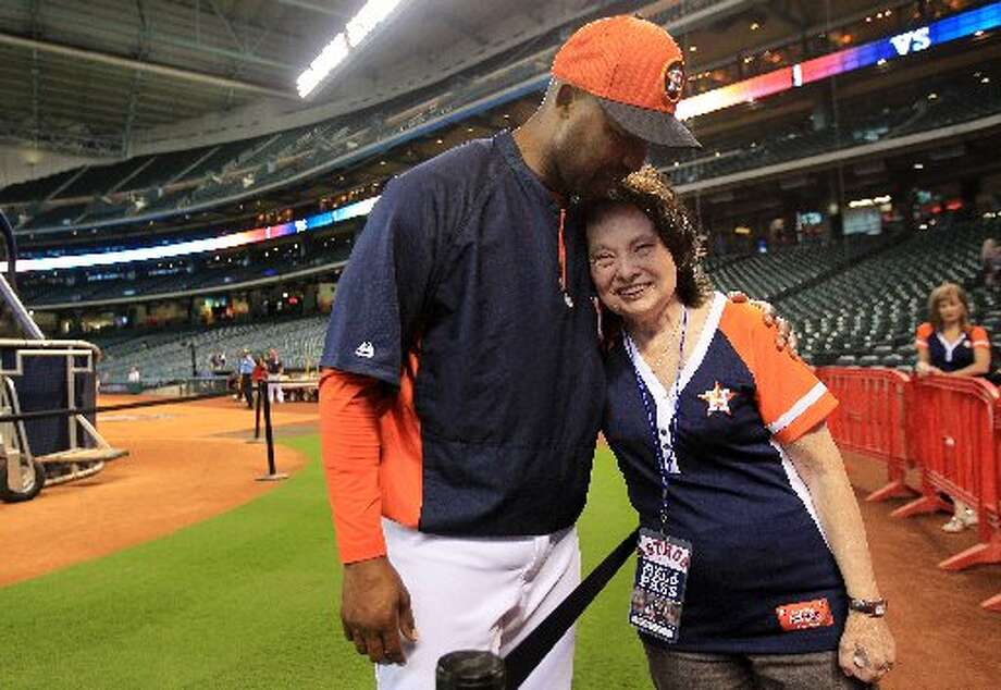 Astros manager Bo Porter embraces Wanda Shannon before she threw out the first pitch at Minute Maid Park on Monday night. Wanda has stage 4 cancer, and it has spread all over her body. She was a runnerup for the MLB At-Bat Against Cancer & Honorary Bat Girl Contest, but didn't win. Despite not winning the contest, the Astros extended an invitation for her to throw out the opening pitch and enjoy field access. Photo: Mayra Beltran, Houston Chronicle