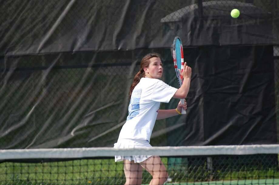 Darien's Kateri Martin returns the ball during the No. 1 singles match of the Wave's away girls tennis match at New Canaan on Monday, May 12. Photo: Dave Crandall / Darien News freelance