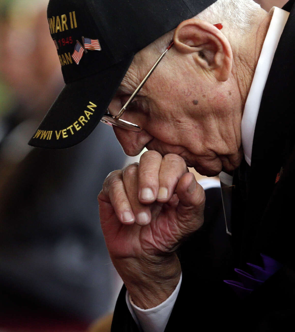 World War II veteran Michael Sgaglione of Middle Island, N.Y., listens to a speaker before receiving the insignia of the French Legion of Honor during a ceremony at the U.S. Military Academy on Friday, May 9, 2014, in West Point, N.Y. Thirty-four U.S. veterans were honored 70 years after of the D-Day landings. (AP Photo/Mike Groll) ORG XMIT: NYMG103
