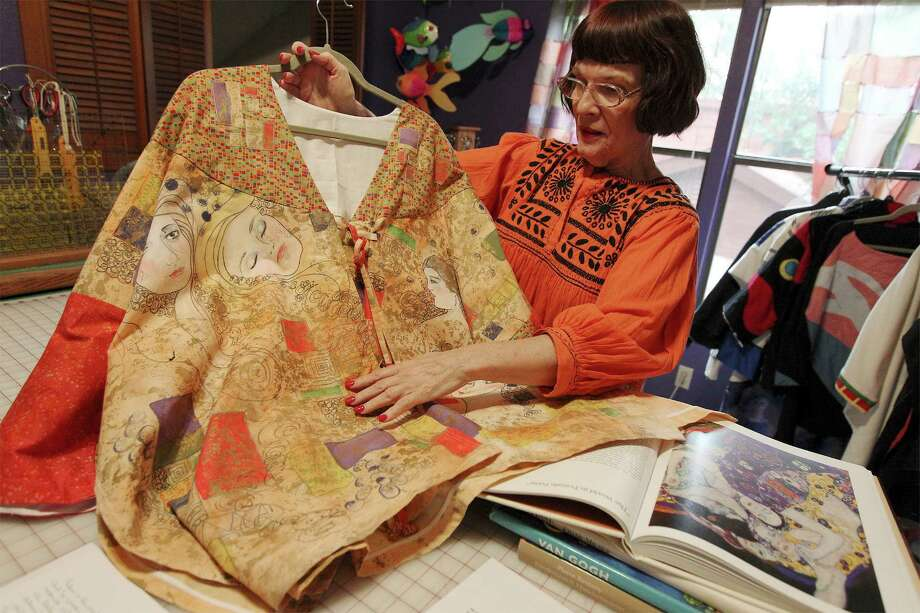Fabric artist Dian (cq) Lamb shows samples of her work for an upcoming show. The theme of the work on the garments was inspired by well-known painters such as Salvador Dali, Vincent Van Gogh and Henri Matisse to name a few. Lamb shows a garment she made inspired by artist Gustav Klimt. Photo: Kin Man Hui, San Antonio Express-News / ©2014 San Antonio Express-News