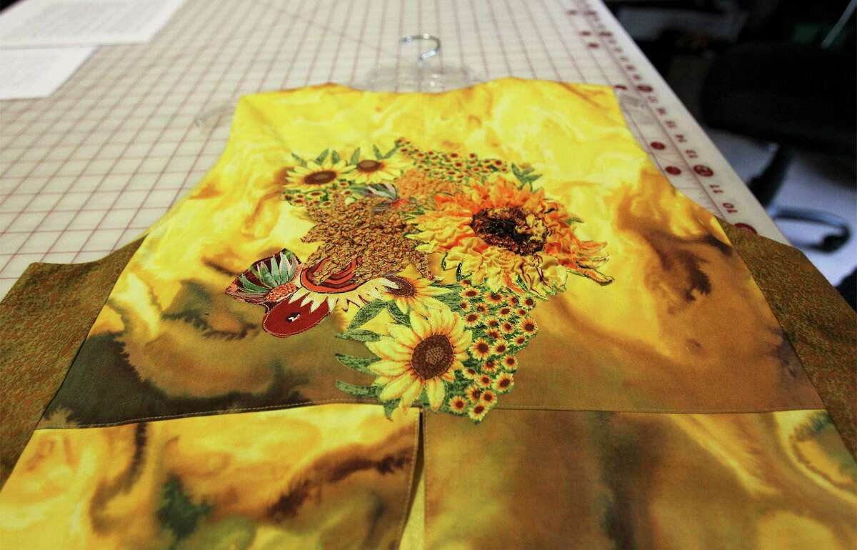 Fabric artist Dian Lamb shows samples of her work for an upcoming show. The theme of the work on the garments was inspired by well-known painters such as Salvador Dali, Vincent Van Gogh and Henri Matisse to name a few. Shown is a garment inspired by Vincent Van Gogh.