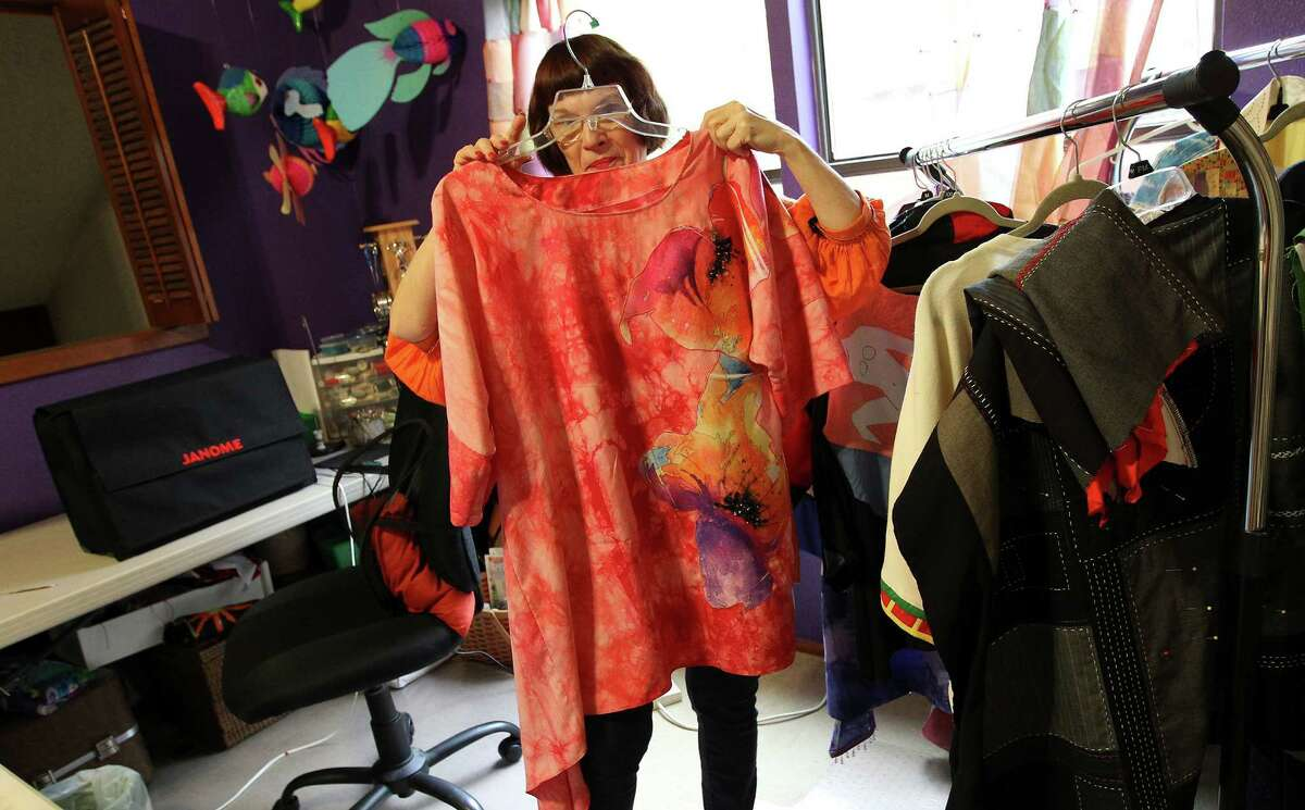 Fabric artist Dian (cq) Lamb shows samples of her work for an upcoming show. The theme of the work on the garments was inspired by well-known painters such as Salvador Dali, Vincent Van Gogh and Henri Matisse to name a few. Lamb holds a garment she made inspired by artist Georgia O'Keefe.