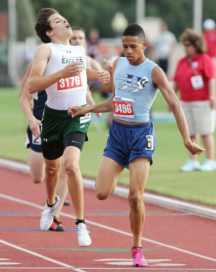Johnson's Robert Ford, right, crosses the finish line of the 5A 800-meter run ahead of Killeen Ellison's Efrain Hernandez during the UIL state track meet  May 10. Ford finished second with 1 minute, 52.01 seconds. Photo: Photos By Marvin Pfeiffer / Stone Oak Weekly / Express-News 2014