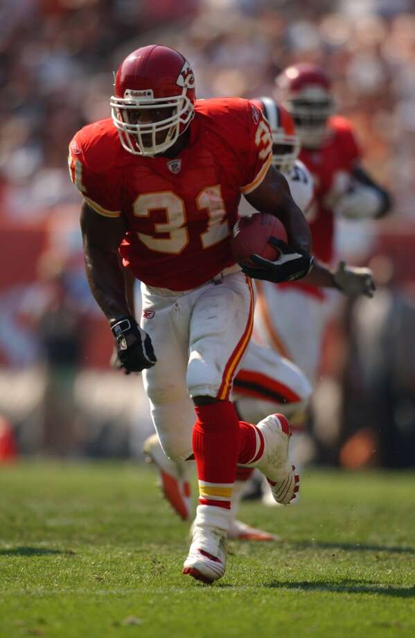Priest Holmes, RB, Texas  The Ravens picked up Holes after the 1997 draft when two RBs were taken in the first round (12th overall by Buccaneers - Warrick Dunn, Florida State and 23rd overall by Bills - Antowain Smith, Houston). Holmes lost his starting job to Jamal Lewis after rushing for over 1,000 yards in 1998. Holes was Lewis' backup when the Ravens won the Super Bowl in 2000. The Chiefs signed Holmes in 2001. That year, he led the league in rushing with 1,555 yards. He led the league in rushing TDs in 2002 and 2003. Holmes broke Marshal Faulk's single-season TD mark by reaching paydirt 27 times in 2003. Holmes is the Chiefs' all-time leader in rushing yards, rushing touchdowns and total touchdowns. He is also a three-time Pro Bowler, a three-time All-Pro and was named NFL Offensive Player of the Year in 2002.  Notable career stats: 82 starts, 8,172 yards, 86 TDs, 339 receptions and 2,962 receiving yards. Photo: Mitchell Layton, Getty Images