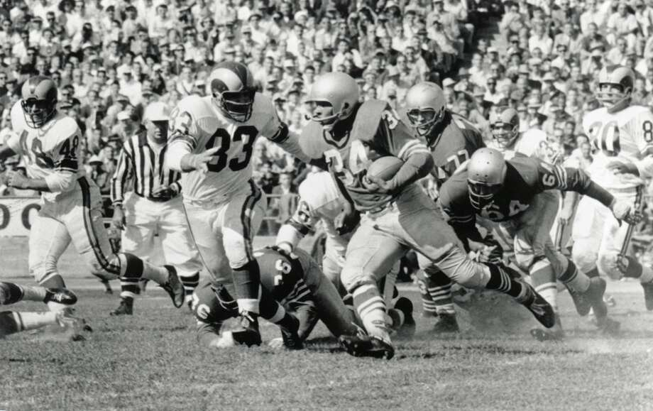 Joe Perry, RB, Compton Community College  Perry joined the 49ers in 1948 where he played until 1961. He played for two years with the Colts before returning to the Niners for his final season in 1963. He led the league in rushing yards three times (1949, 1953 and 1954), rushing TDs three times (1948, 1949 and 1953) and also attempted six field goals over the course of his 16-year career. He was the first player to rush for 1,000+ yards in back-to-back seasons. Perry was a Pro Bowler three times, a two-time first team All-Pro and was named to the Hall of Fame.  Notable career stats: 181 games, 9,723 rushing yards, 71 rushing TDs, 2,021 receiving yards and 12 receiving TDs. Photo: Robert Riger, Getty Images