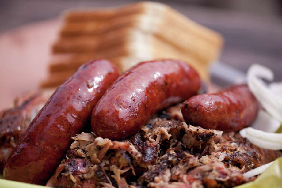 Pulled pork and sausages from Franklin Barbecue in Austin. Photo: Paul Sedillo