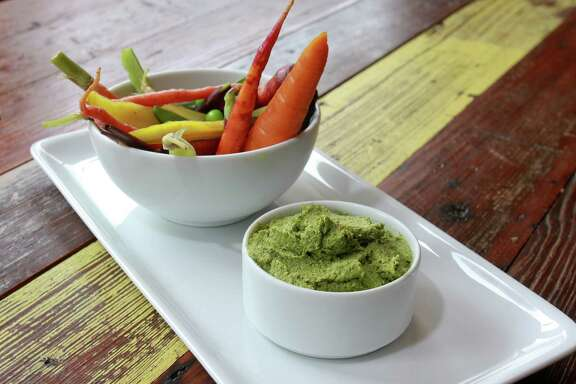 (For the Chronicle/Gary Fountain, May 9, 2014) Snow peas, backyard carrots, and carrot top pesto at Coltivare, 3320 White Oak in the Heights.