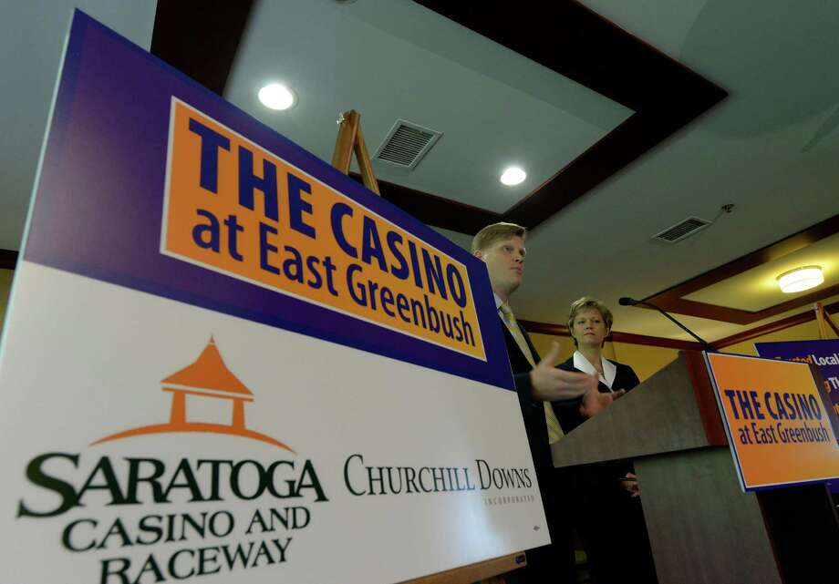 Shawn Bailey of Churchill Downs Incorporated, left, is joined by Rita Cox of the Saratoga Casino and Raceway during an announcement of a partnership between the two companies on development of a full service casino in East Greenbush Tuesday morning, May 13, 2014, during a press conference  in East Greenbush, N.Y.  (Skip Dickstein / Times Union) Photo: SKIP DICKSTEIN / 00026871A