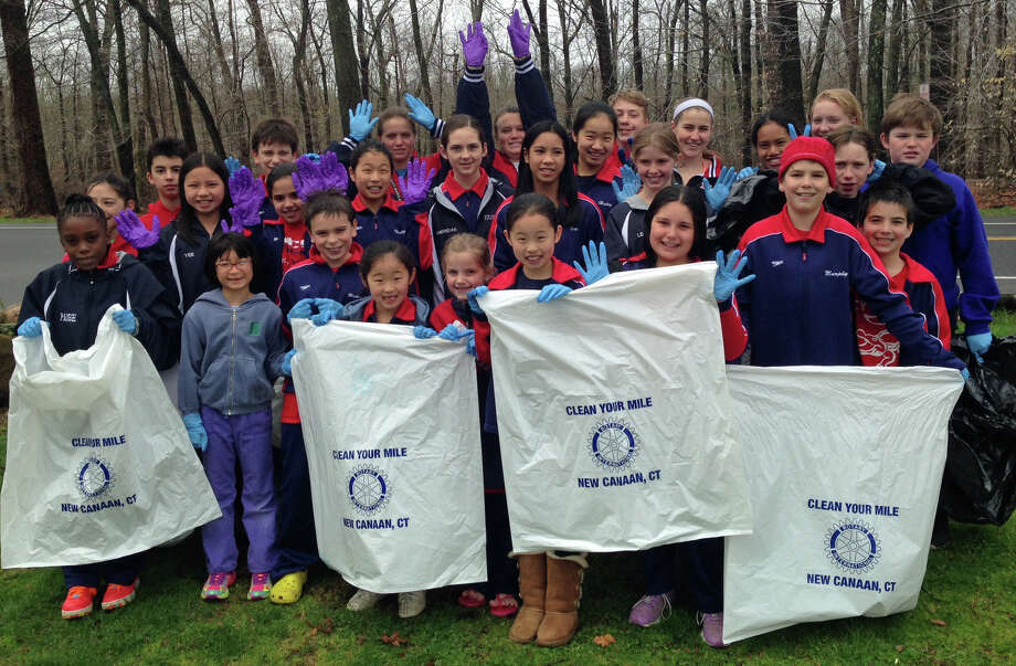 Swimmers from the New Canaan YMCA Caimans swim team recently participated in ìClean Our Mileî outside of the Y. Photo: Contributed Photo, Contributed / New Canaan News Contributed