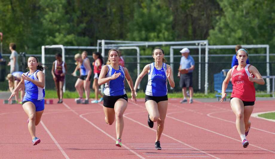 Darien girls track runners finish the 100-meter dash Monday in a home meet against Fairfield Warde and St. Joseph Photo: Contributed Photo, Contributed / Darien News Contributed