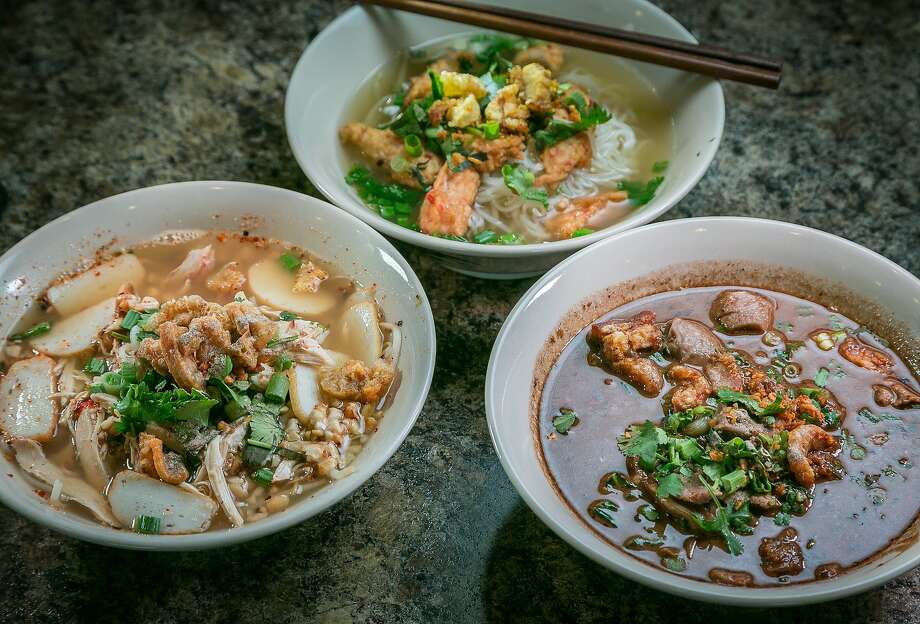 Clockwise from top: Noodle options include sweet-sour chicken (left), fried fish ball and Thai boat noodles. Broth is poured over noodles. The wall of snacks has items like dried fruits and basil potato chips. Photo: John Storey, Special To The Chronicle