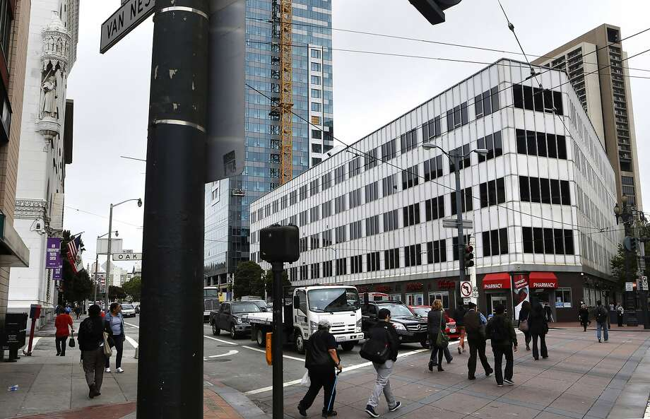The five story property at 30 Van Ness Ave.(right) on the corner of Market St., in San Francisco, Calif., as seen on Thursday May 8, 2014, is currently in contract talks with a major developer. The four corners at the intersection of Market St. and Van Ness Ave. will soon be the home of several thousand housing units in the next several years. Photo: Michael Macor, The Chronicle