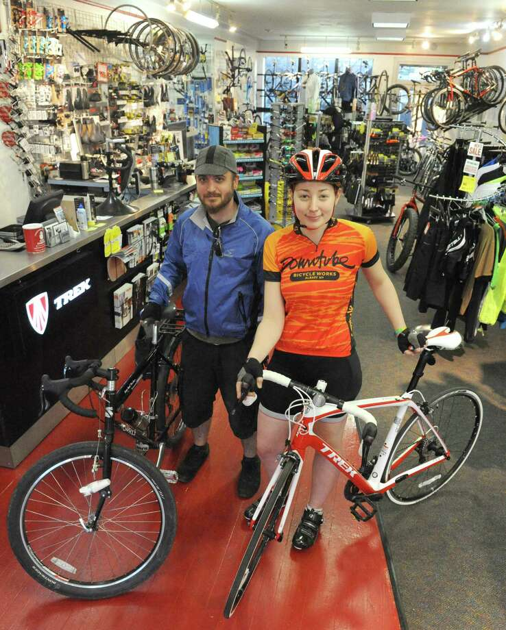 Oliver Leue and Becky Puritz of the Downtube Bicycle Works on Wednesday May 7, 2014 in Albany, N.Y. (Michael P. Farrell/Times Union) Photo: Michael P. Farrell / 00026743A