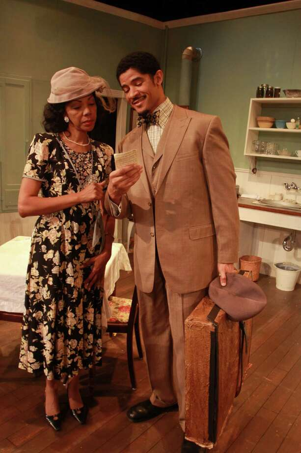 "Elizabeth (Detria Ward) takes in Husband (Roc Living) to help pay the bills, but things begin to heat up romantically between the two in the Ensemble Theatre's production of ""The Old Settler."" Photo: Gary Fountain, Freelance / Copyright 2014 by Gary Fountain"