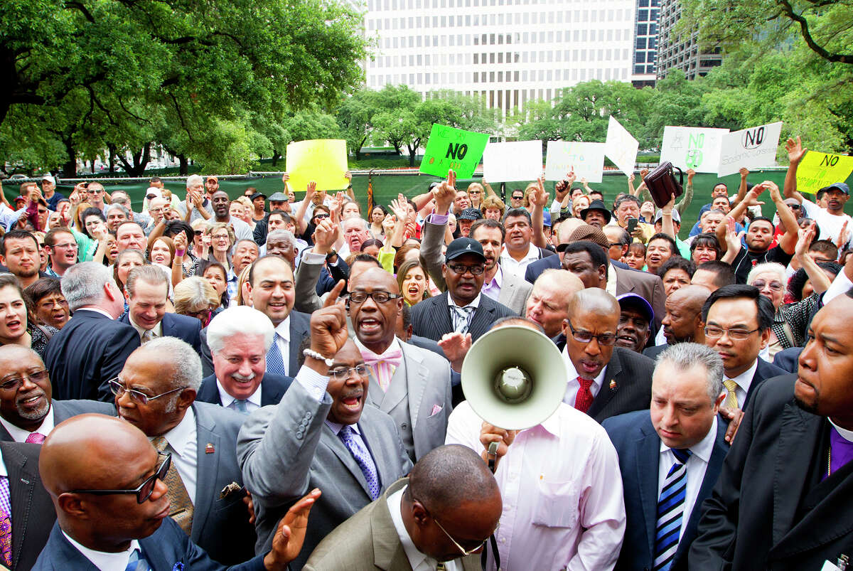 Protestors gather outside of City Hall after Mayor Annise Parker and supporters of her proposed nondiscrimination ordinance announced a compromise, Tuesday, May 13, 2014, in Houston. The proposed change in the Houston Equal Rights Ordinance would specify that no business open to the public could deny a transgender person entry to the restroom consistent with his or her gender identity.