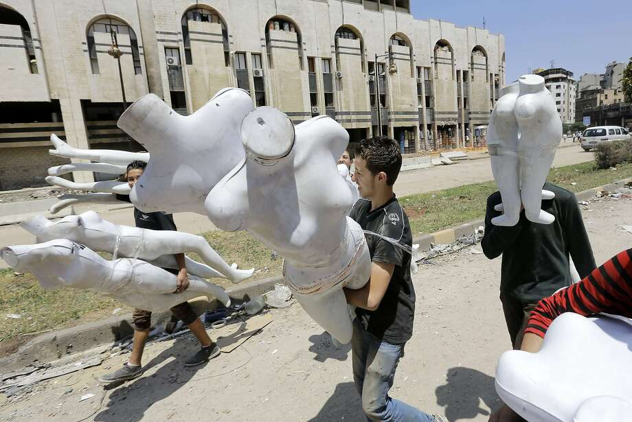 Thank goodness the mannequins were still there:Syrians return to a destroyed neighborhood 