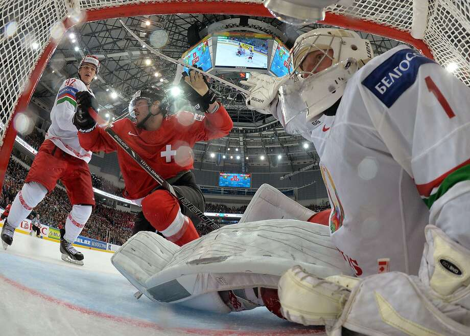 But how did the photographer get in the net? Switzerland's forward 