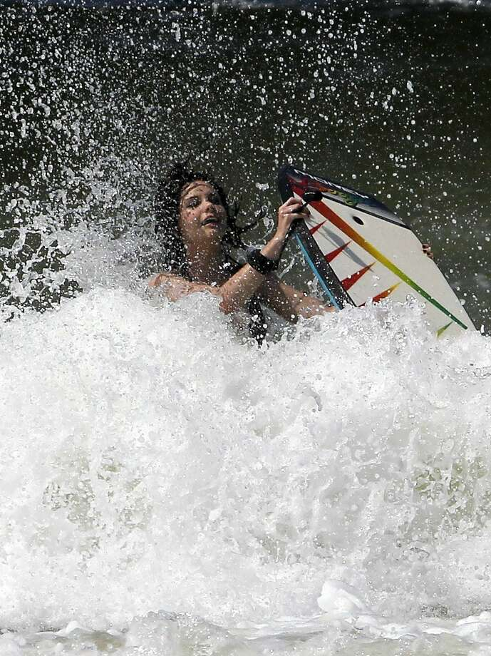 Cece rider: Cece Nash is knocked off her boogie board while riding a big wave in Panama 