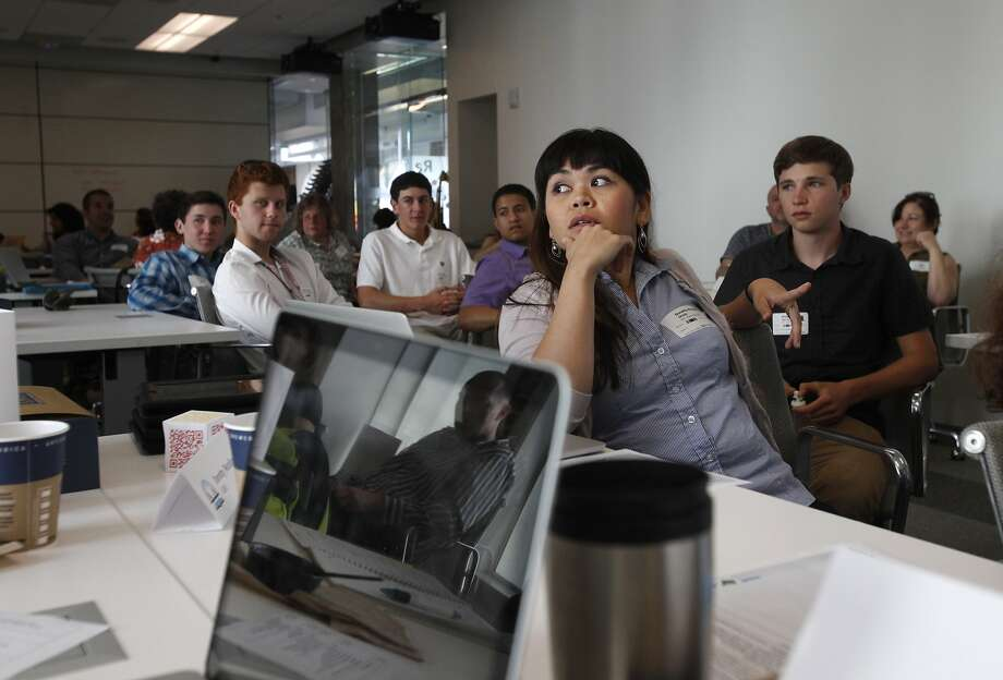 Dorothy Morallos (right center) of James Lick Middle School listens during a 3-D modeling workshop at the Autodesk gallery in S.F. Photo: Leah Millis, San Francisco Chronicle