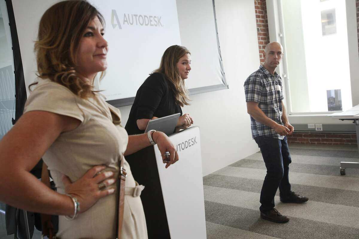 Torie Anderson, Manager of Marketing for Autodesk, center, introduces another presenter as Michele Dawson Supervisor of Educational Technology with SFUSD and SteveTemple teacher at San Rafael High School stand at left and right during the Design the Future--SFUSD: Integrating 3D Modeling into the Curriculum workshop May 13, 2014 at the Autodesk gallery in San Francisco, Calif.