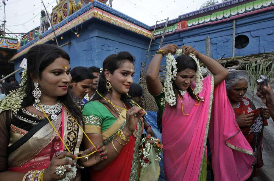 "Eunuchs display their holy strings after a group marriage ceremony during the eunuch festival in Koovagam, Tamil Nadu state, India. Eunuchs from all over India gather in this village to re-enact a story adopted from the epic ""Mahabharata,"" in which they symbolically marry Aravan, believed to be the patron god of transgender communities. Photo: Arun Sankar K, Associated Press"