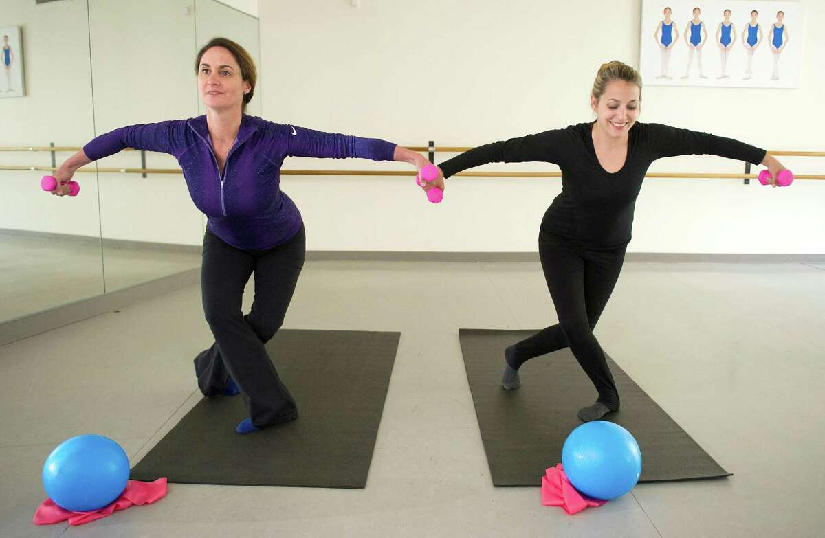 Maia Fitzpatrick, left, and Danielle Sullo, right, show some the moves they lead students in during the Ballet School of Stamford's new Barre Results exercise classes in Stamford, Conn., on Tuesday, May 13, 2014.