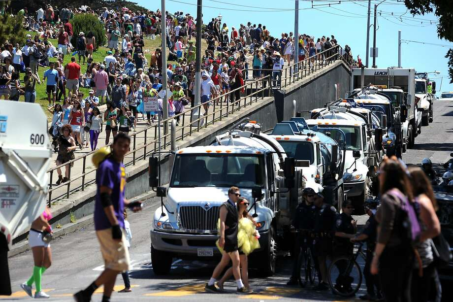 Street-cleaning trucks are lined up on Hayes Street next to Alamo Square Park after last year's Bay to Breakers race. The park has been a popular spot for spectators and for participants taking a break. Photo: Michael Short, Special To The Chronicle