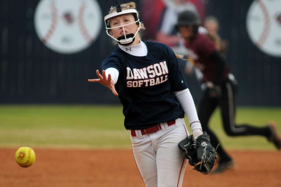 Pearland Dawson senior pitcher Megan Stone works to a Pearland hitter during their scrimmage at Pearland Dawson High School. Photo: Jerry Baker, Freelance