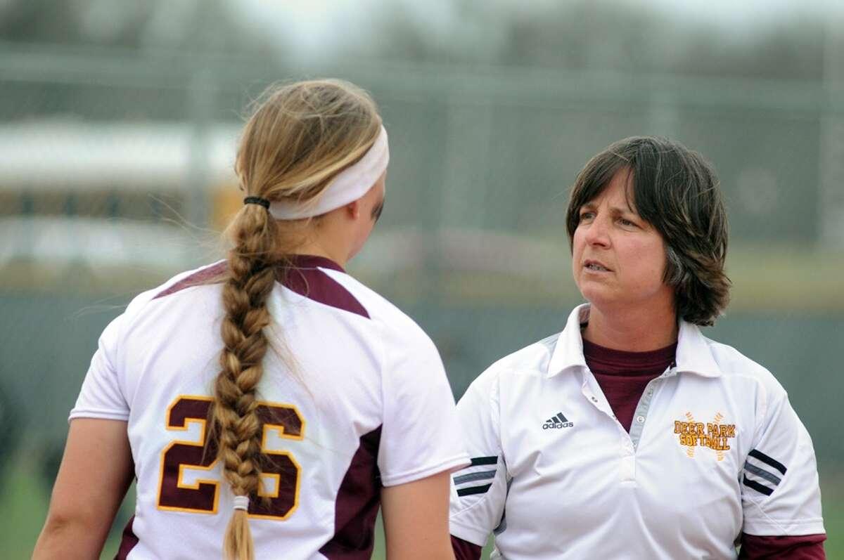 Deer Park head coach Carrie Austgen, right, chats with pitcher Payton McBride.